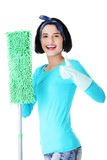 Happy cleaning woman gesturing thumbs up Stock Photography