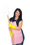 Happy cleaning woman holding mop. Happy cleaning woman with pink apron and yellow gloves showing her mop isolated on white background stock images