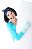 Happy cleaning woman showing blank sign board. Smiling happy cleaning woman showing blank sign board Stock Photo