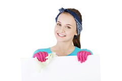 Happy cleaning woman showing blank sign board. Stock Photo
