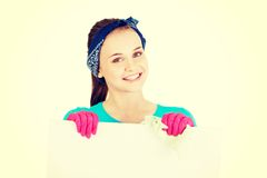 Happy cleaning woman showing blank sign board. Stock Photography