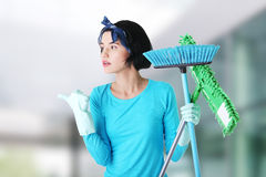 Happy cleaning woman showing copy space. Stock Photos