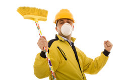 Happy cleanner. Men with protective uniform and a broom, happy with his job royalty free stock photography