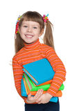 Happy clever little girl with books Stock Photo
