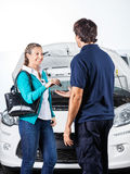 Happy Client Giving Car Keys To Mechanic Stock Photography