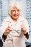 Happy client with new eyeglasses Royalty Free Stock Photo