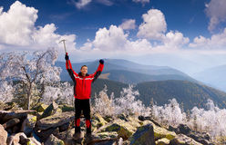 Happy climber with an ice pick Stock Images