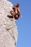 Happy climber near the top of. The wall Royalty Free Stock Photography