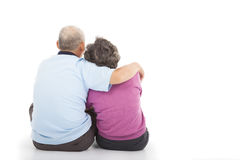 Happy closeness senior couple sitting on the floor. Over white background Stock Photos