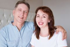 Happy closeup people faces. Smiling middle age couple at home. Family fun time weekend and strong love relationship. Healthy smile. With white teeth. Dental royalty free stock image