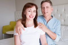 Happy closeup people faces. Smiling middle age couple at home. Family fun time weekend and strong love relationship. Healthy smile. With white teeth. Dental royalty free stock images