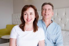 Happy closeup people faces. Smiling middle age couple at home. Family fun time weekend and strong love relationship. Healthy smile. With white teeth. Dental stock photography