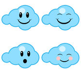 Happy clouds. Four happy clouds with different faces Royalty Free Stock Photos