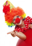 Happy clown. Pointing on something Royalty Free Stock Photography