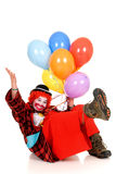 Happy clown. Happy smiling female clown, colorful dressed, studio shot on white background Royalty Free Stock Photos
