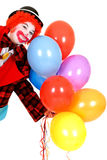Happy clown. Happy smiling female clown, colorful dressed, studio shot on white background Royalty Free Stock Photo