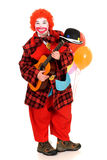 Happy clown. Happy smiling female clown, colorful dressed, studio shot on white background Royalty Free Stock Images