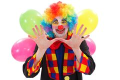 Happy clown with balloons, gesturing with hand Royalty Free Stock Images