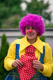 Happy clown with big red tie. Performing his show Royalty Free Stock Images