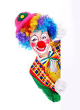 Happy clown with the blank board. Vertical portrait of a happy clown holding the blank board Stock Image
