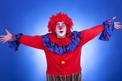 Happy clown on blue background Stock Images