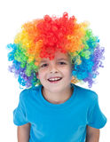 Happy clown boy - isolated portrait. Happy clown boy with large colorful wig - isolated Royalty Free Stock Images