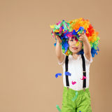 Happy clown boy with large colorful wig Stock Images