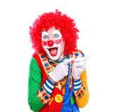 Happy clown closeup portrait. Happy clown pointing to the copy space area Royalty Free Stock Photography