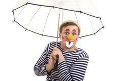 A happy clown with a funny expression. Isolated image on white background, Studio shot Royalty Free Stock Photography