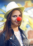 Happy clown with hat. Happy clown girl with white hat Royalty Free Stock Images