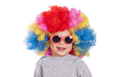Happy clown. Happy little child wearing clown wig and retro style sunglasses Stock Image
