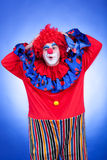 Happy clown men on blue background Stock Photo