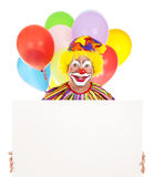 Happy Clown With Message. Happy clown holding a blank sign ready for your text.  White background Stock Photos