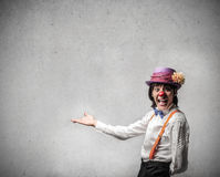 Happy clown showing something Royalty Free Stock Photo