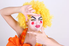 Happy clown take a photo Royalty Free Stock Photo