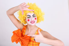 Happy clown take a photo Stock Images