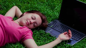 Happy co-worker lying on grass stock video