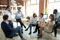 Happy coach laughing at employee joke at briefing. Happy smiling coach, tutor, boss laughing at female employee joke at briefing, colleagues having fun together royalty free stock photography