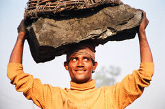 Happy coal worker, india. People pick pieces of black coal near the coal mines Royalty Free Stock Images