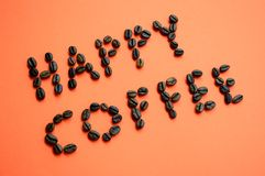 Happy coffee. Happy coffe , coffee beans on orange background Royalty Free Stock Photography