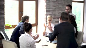 Happy colleagues applaude at the end of a business meeting. Happy Coworkers Applaud At The End Of A Business Meeting. Cheerful Colleagues Clap Their Hands stock video