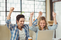 Happy colleagues cheering in office Royalty Free Stock Image