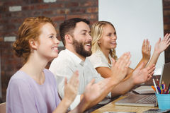 Happy colleagues clapping at meeting Royalty Free Stock Photos