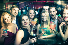 Happy colleagues dancing on corporate party Royalty Free Stock Image