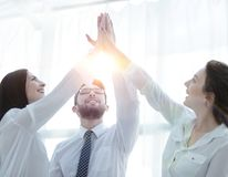 Happy colleagues giving each other a high five. Business concept royalty free stock photos