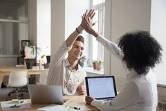 Happy colleagues giving high five satisfied with high results. Happy casual colleagues giving high five satisfied with good results or growing statistics royalty free stock photography