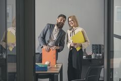 Happy colleagues in modern office. Business couple smile meeting in office. Bearded man and sensual woman smiling with. Happy colleagues in modern office stock image