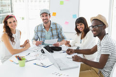 Happy colleagues sitting and looking at camera Royalty Free Stock Image