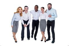Happy colleagues smiling and having a break. Best team ever. Attractive exuberant stylish young successful colleagues smiling and hugging and wearing white royalty free stock photography