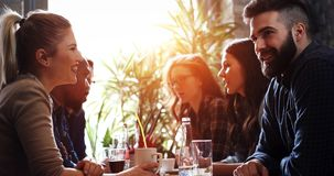 Happy colleagues from work socializing in restaurant royalty free stock image